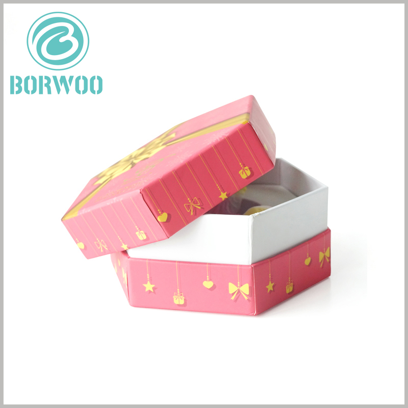 80ml perfume spray bottle packaging with bronzing printing. The printed hexagonal cardboard boxes, the packaging is hard, can isolate the external damage to the perfume products inside the packaging.