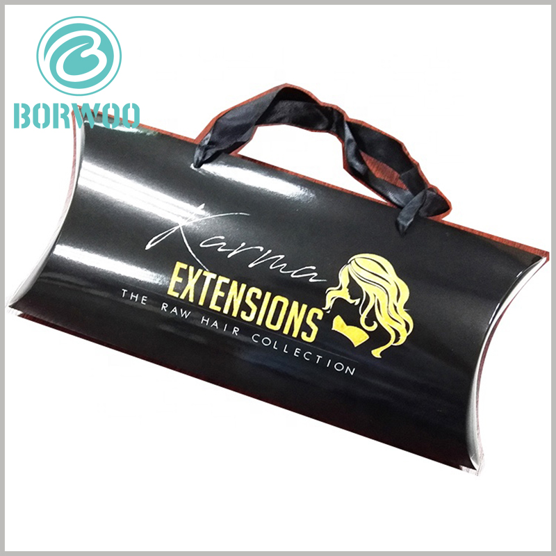 Black hair extensions packaging boxes with bronzing printing. There are black silk belts on the side edges of the pillow boxes to increase the convenience of carrying products.