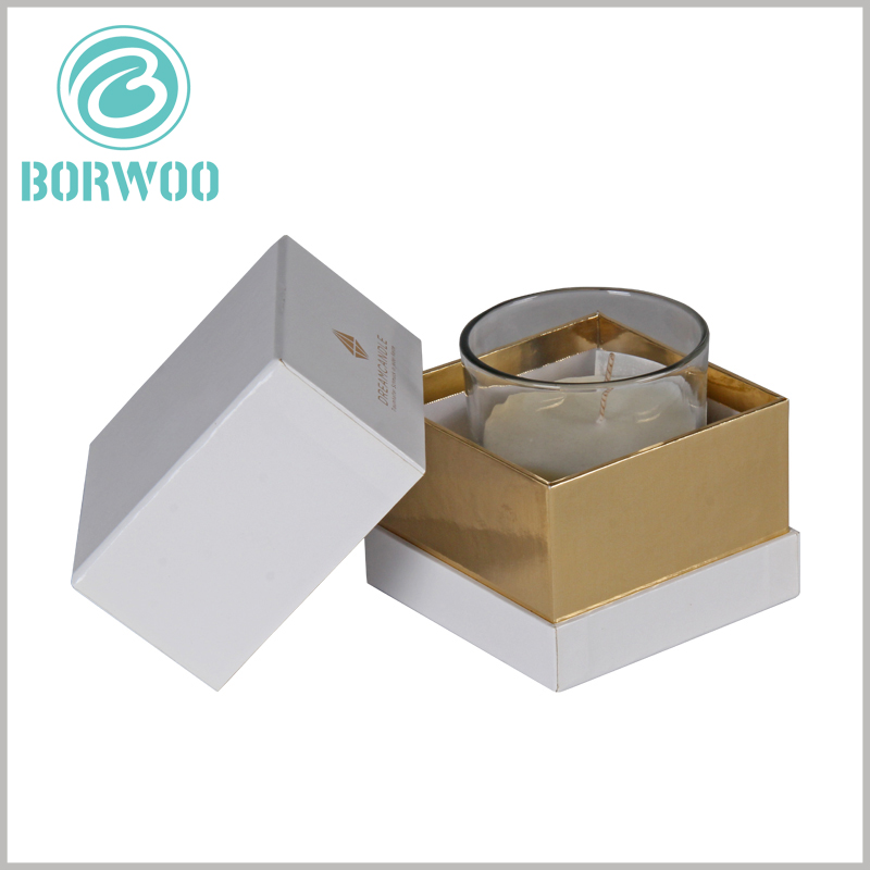 White square cardboard boxes for candle packaging. Small cardboard boxes have lids, and the inner neck of the packaging uses gold cardboard as laminated paper. The packaging has a luxurious visual sense.