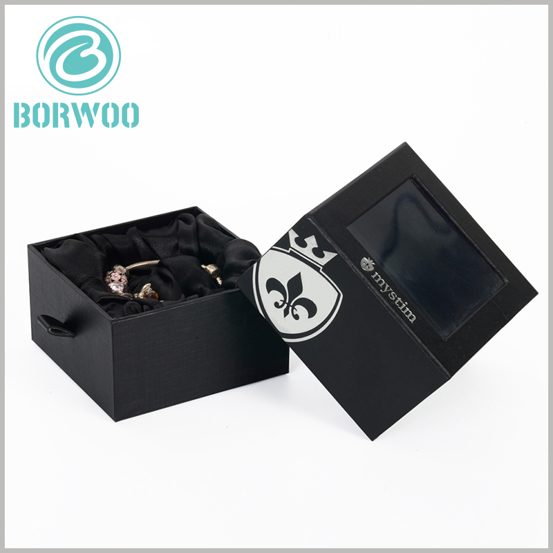 black bracelets gift packaging boxes with windows. The outer box laminated paper of the black product packaging box is different from the inner box laminated paper, and also has a different visual experience.