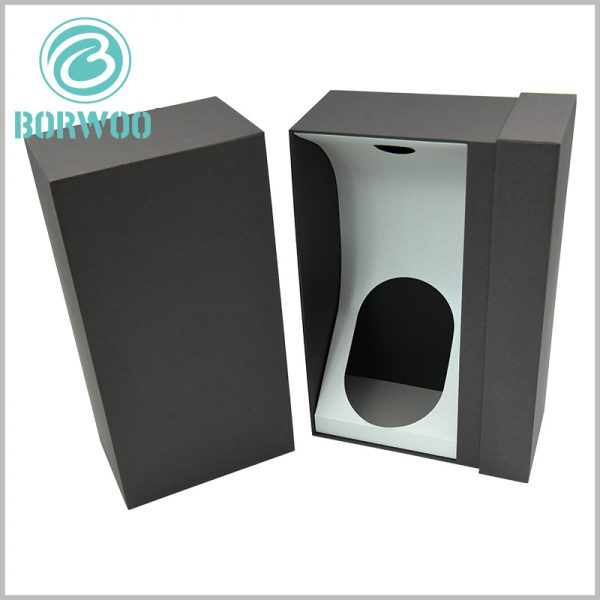 black cardboard drawer boxes for wine bottles packaging. The inside of the custom packaging box has white cardboard as an insert to fix the neck and bottom of the wine bottle to ensure the stability of the product.