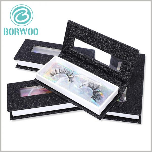 black cardboard eyelash box packaging with window.There is laser paper as decoration under the transparent blister, and the inside of the package has different colors and reflections from different angles.