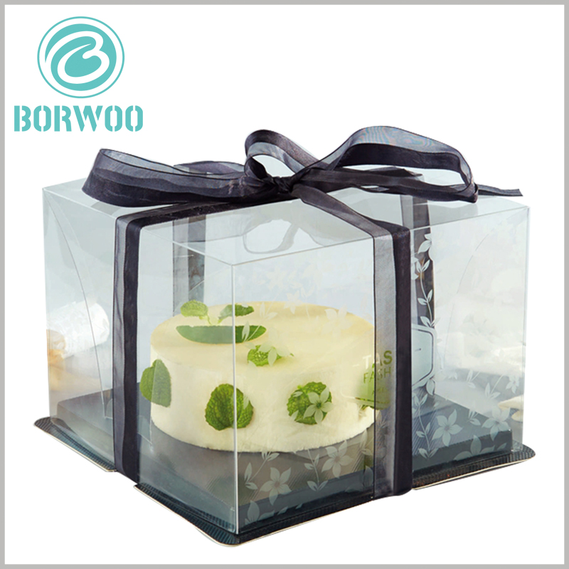 clear cake boxes with black ribbon. The black cardboard tray can bear heavier weight compared to the PET tray.