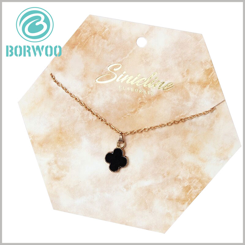 creative jewelry hang tags wholesale.The brand information on the hexagonal tag packaging is printed by bronzing, which is one of the best ways to promote the product.