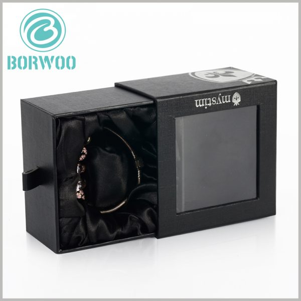 custom black bracelets gift boxes with windows. There are inserts and black silk cloth inside the package to fix and protect the bracelet jewelry.