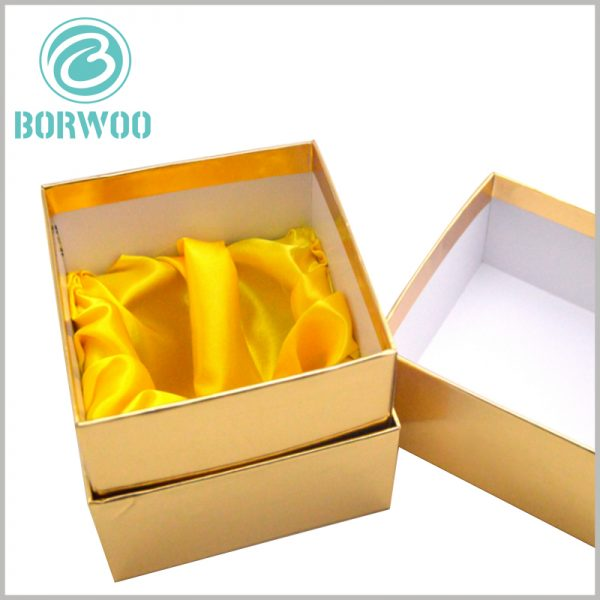 custom gold cardboard boxes for candles. There are inserts inside the custom candle packaging to fix the candle jar, and use yellow silk as the interior decoration.