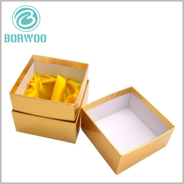 custom gold cardboard boxes for candles packaging. Square cardboard boxes with lids, the necks of custom cardboard boxes also use gold cardboard as laminated paper