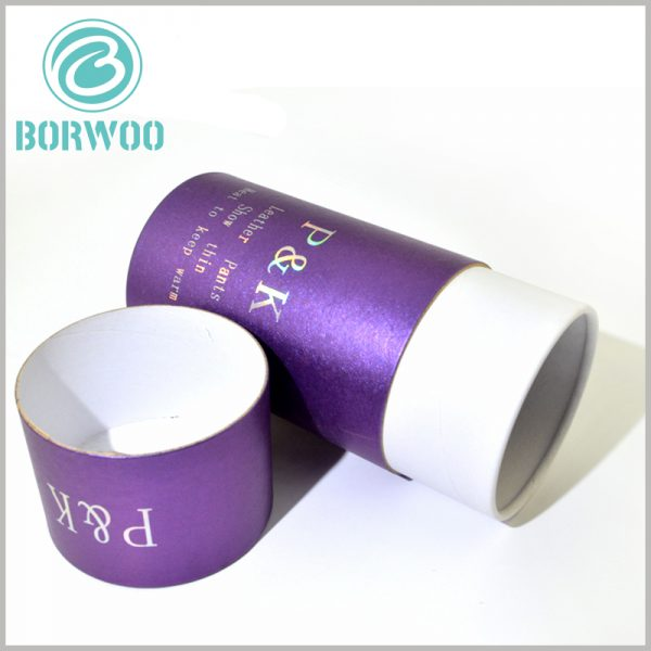 custom purple cardboard round boxes for leather pants packaging. The cardboard cylinder packaging uses 350gsm cardboard as the raw material, and the top edge of the inner tube has a smooth curling edge.