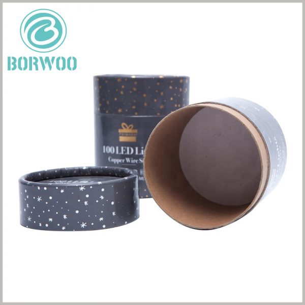 custom round boxes with lids for 100 led lights. The paper tube packaging is made of high-quality kraft paper as one of the raw materials, and the laminated paper is printed 128gsm coated paper