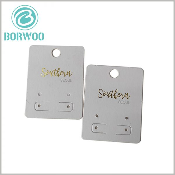 custom white paper hang tag for jewelry. Jewelry hang tags use a combination of bronzing printing and spot color printing, the main purpose is to create and promote the brand.