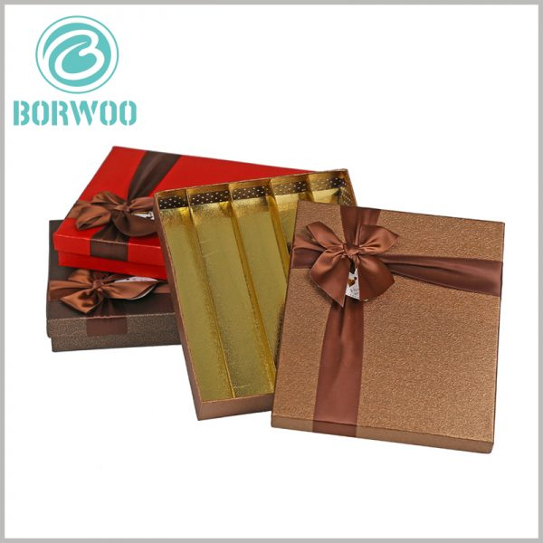 large gift boxes with ribbon for 30 chocolates packaging. Gold cardboard is used as an internal insert in the package, which can divide the internal space of the package and play a decorative role.