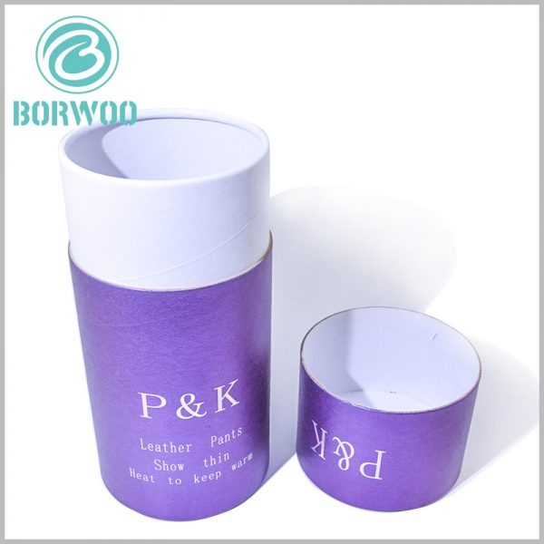 purple cardboard round boxes for leather pants packaging.The outer tube of cardboard cylinder packaging uses printed paper as laminated paper to improve the outer tube and display content of the packaging.