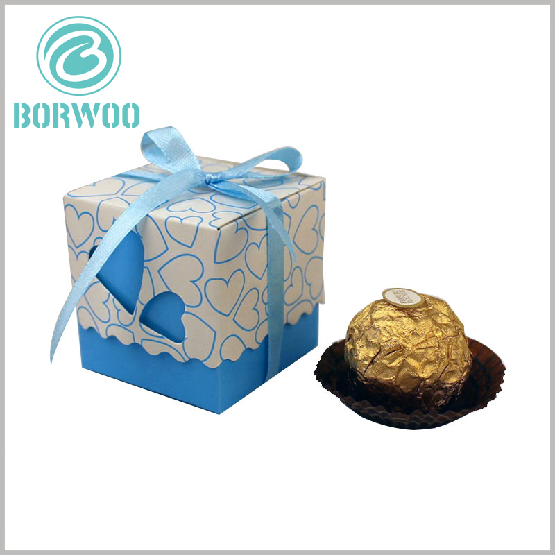 small chocolate gift boxes packaging with gift bows. The square chocolate packaging has a variety of different colors to reflect different flavors of chocolate.