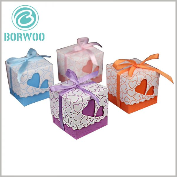 small gift boxes packaging with gift bows. The square cardboard chocolate packaging is designed with different heart-shaped hollow patterns, which give the product more gift value.