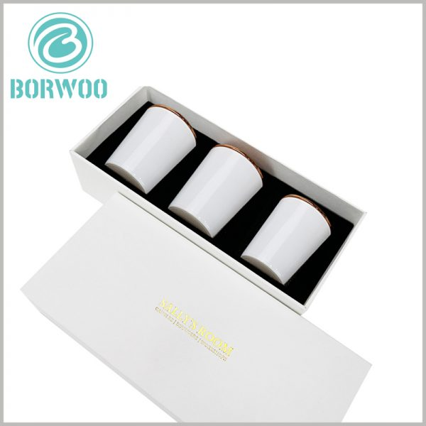 white cardboard candle box packaging for 3 jars. The 3 candle jars are arranged neatly inside the package, and the product is presented to consumers in the best form.