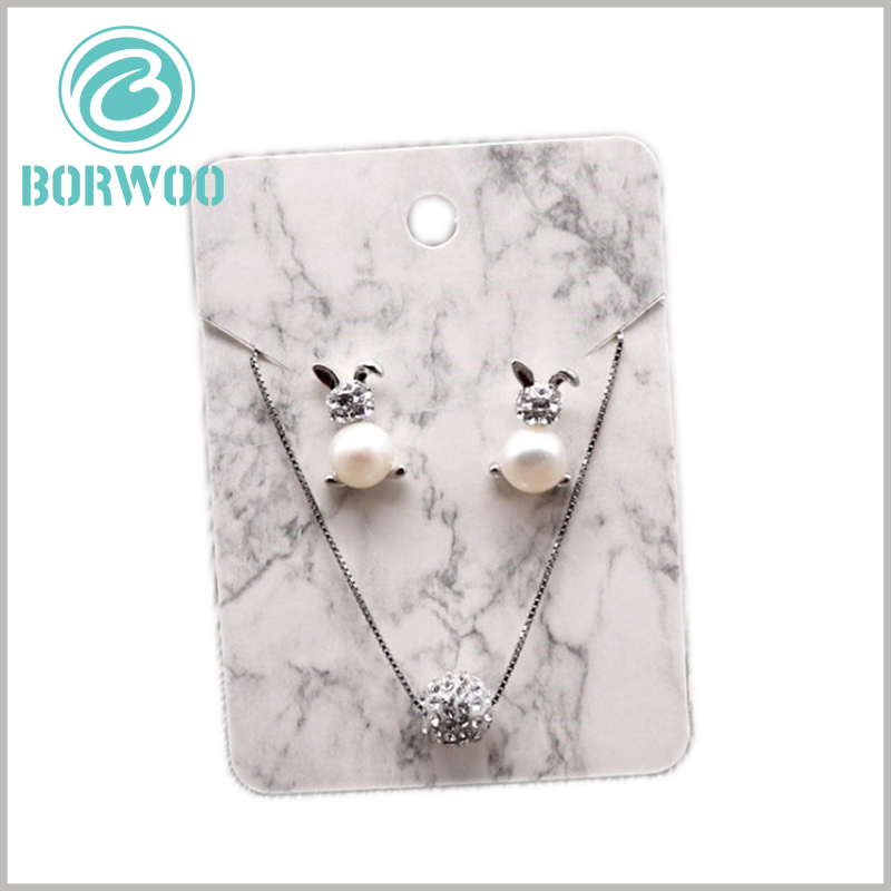 white creative paper hang tag for jewelry. As the main element of the paper tag design, the white marble pattern is very unique and attractive.