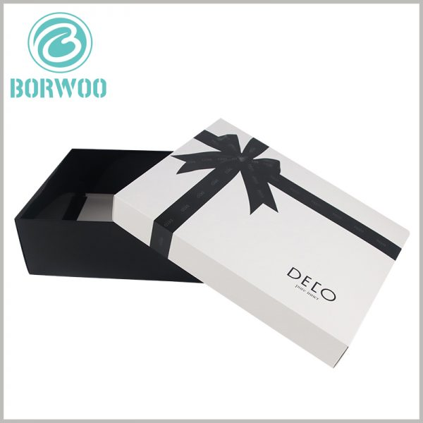 white large gift boxes with lids wholesale. Gift boxes are covered with silk patterns as decorations. Silk gift bows are printed with emboss, and the patterns have obvious concavity and convexity.